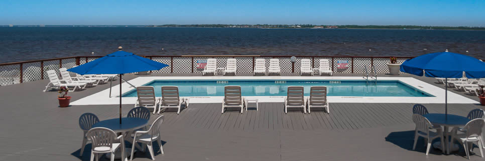 Palm Beach Club Condominium pool overlooking Pensacola Bay in Pensacola Beach