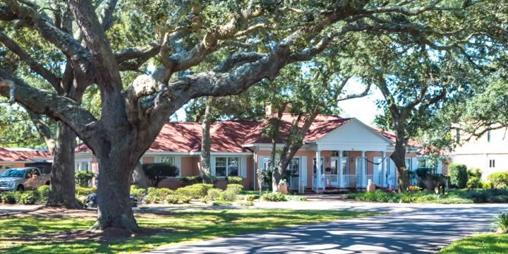 Star Lake house in a tree-lined street in Pensacola FL