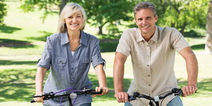 Couple riding bicycles.