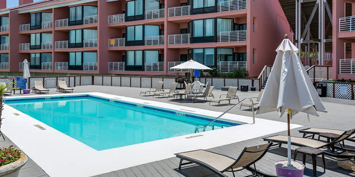 Pool and deck at Palm Beach Club Condominiums overlooking Pensacola Bay